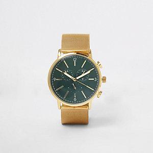 Horloge met ronde wijzerplaat en goudkleurig bandje van mesh