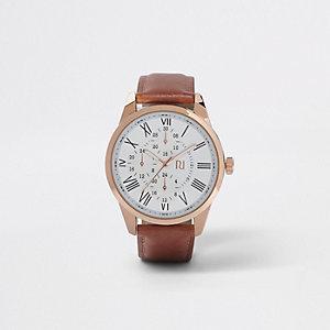 Bruin en rozegoudkleurig horloge met ronde wijzerplaat