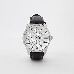 Zwart en zilverkleurig horloge met ronde wijzerplaat