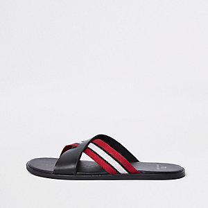 Zwarte gestreepte slippers met gekruiste bandjes