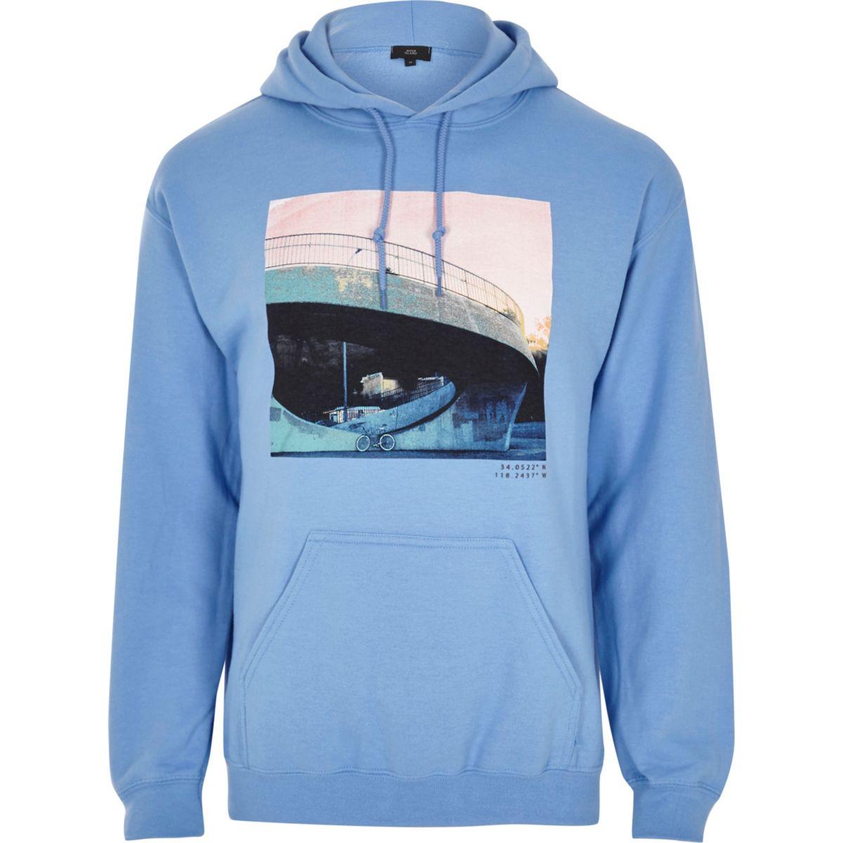 Blauwe hoodie met urban fotoprint