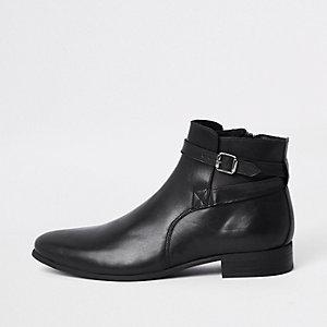 Zwarte leren laarzen met bandje en gesp