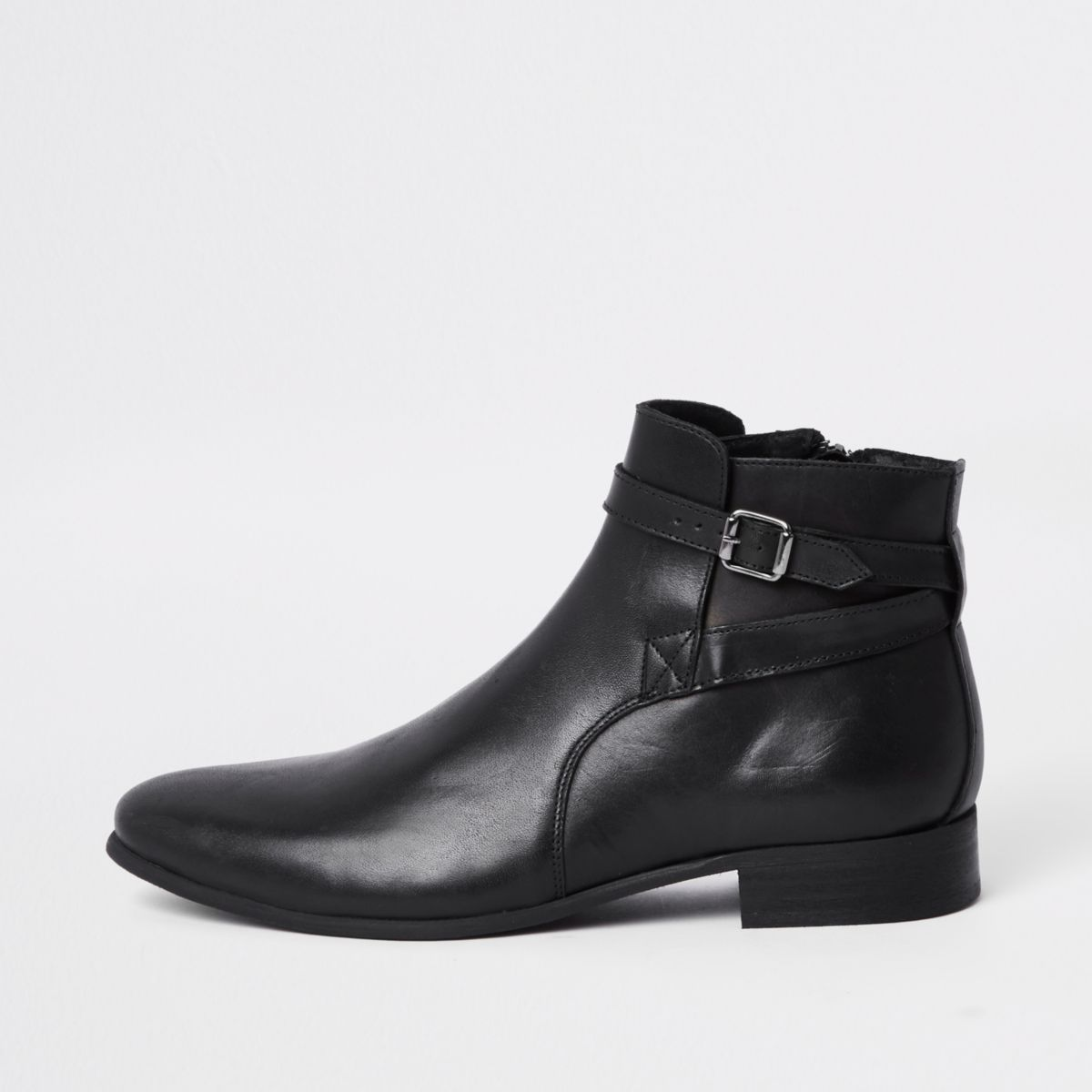 Black leather buckle strap boots