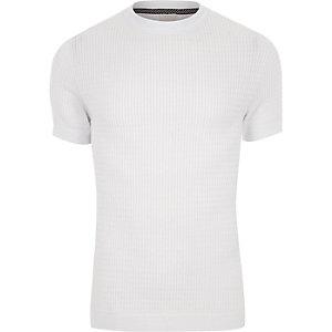 Wit gebreid aansluitend T-shirt met kabelmotief