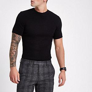 Zwart gebreid aansluitend T-shirt met korte mouwen en kabelmotief