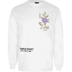 Witte top met geborduurde bloem en print en lange mouwen
