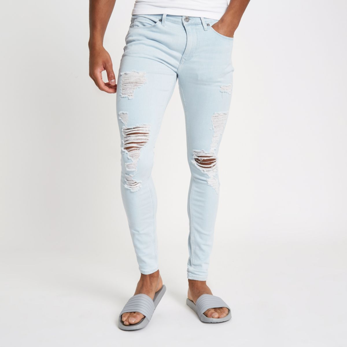 Light Blue Ollie Ripped Spray On Skinny Jeans by River Island