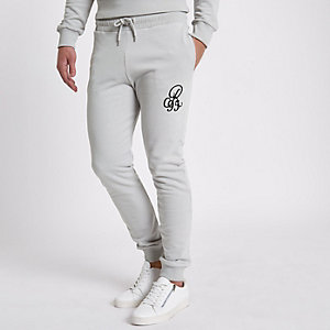 Pantalon de jogging slim gris à inscription brodée R95