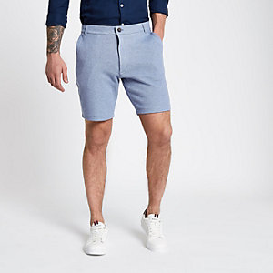Blauwe tailored slim-fit short van piqué-stof