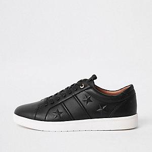 Zwarte sneakers met ster in reliëf