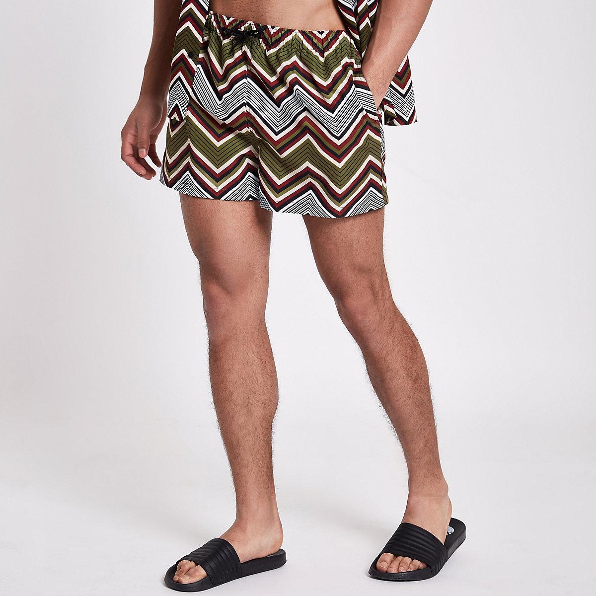 Green zig zag print swim shorts