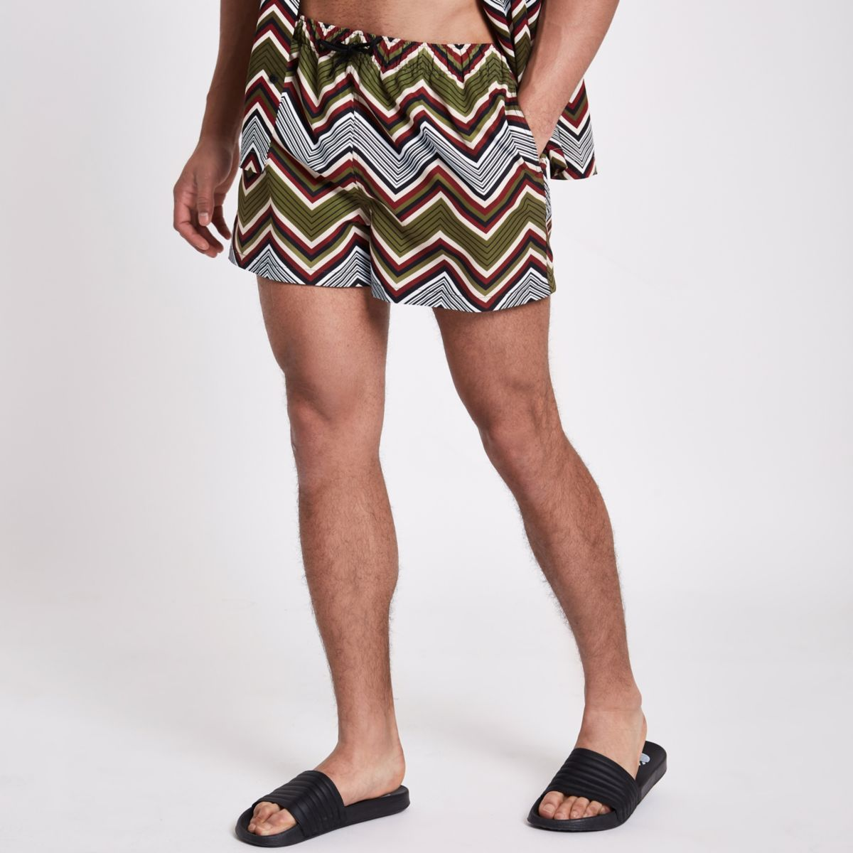 Green zig zag print swim trunks