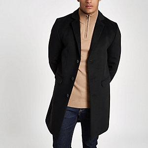 Zwart geklede overjas met knoopsluiting