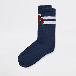 Marineblauwe sokken met geborduurde roos