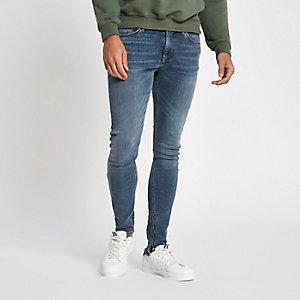 Danny – Jean super skinny bleu moyen à zips aux chevilles