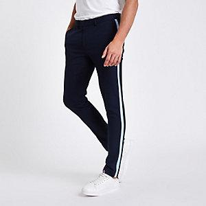 Marineblauwe nette skinny broek met streep opzij