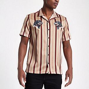 Chemise rayée grège avec col à revers et motif loup brodé