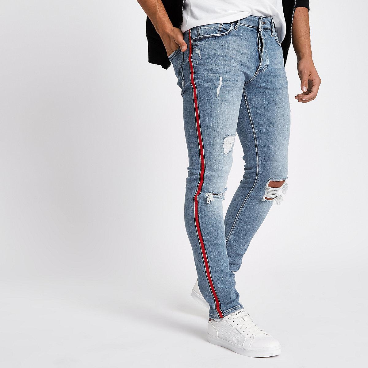 Light blue Sid tape ripped skinny jeans