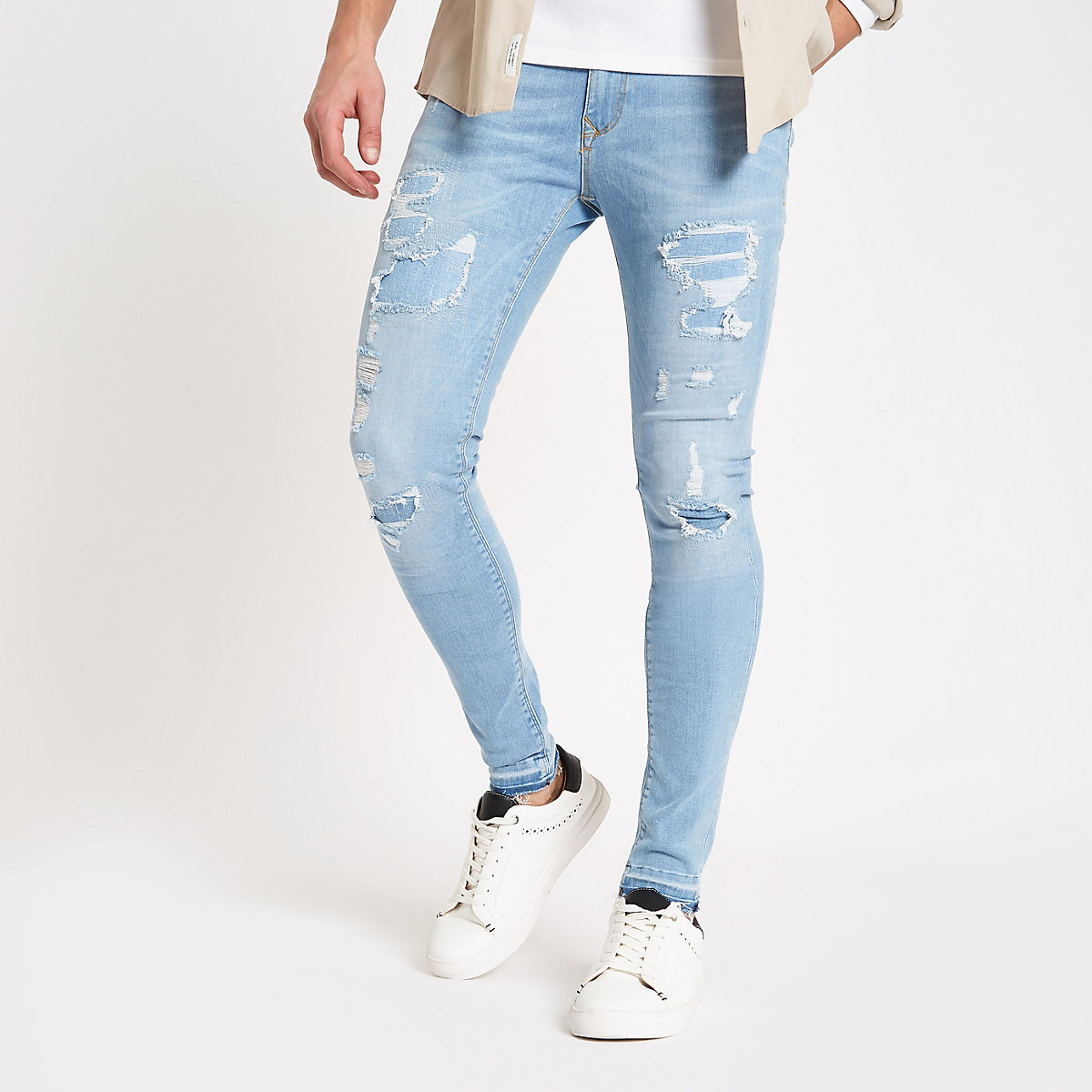 Light blue ripped Ollie skinny spray on jeans