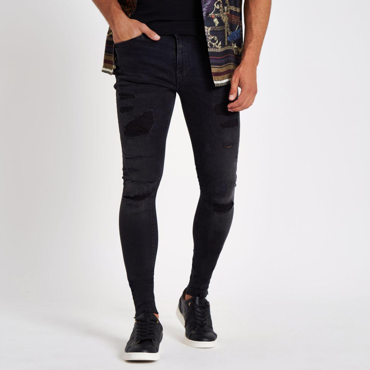 Black Ollie rip super skinny spray on jeans