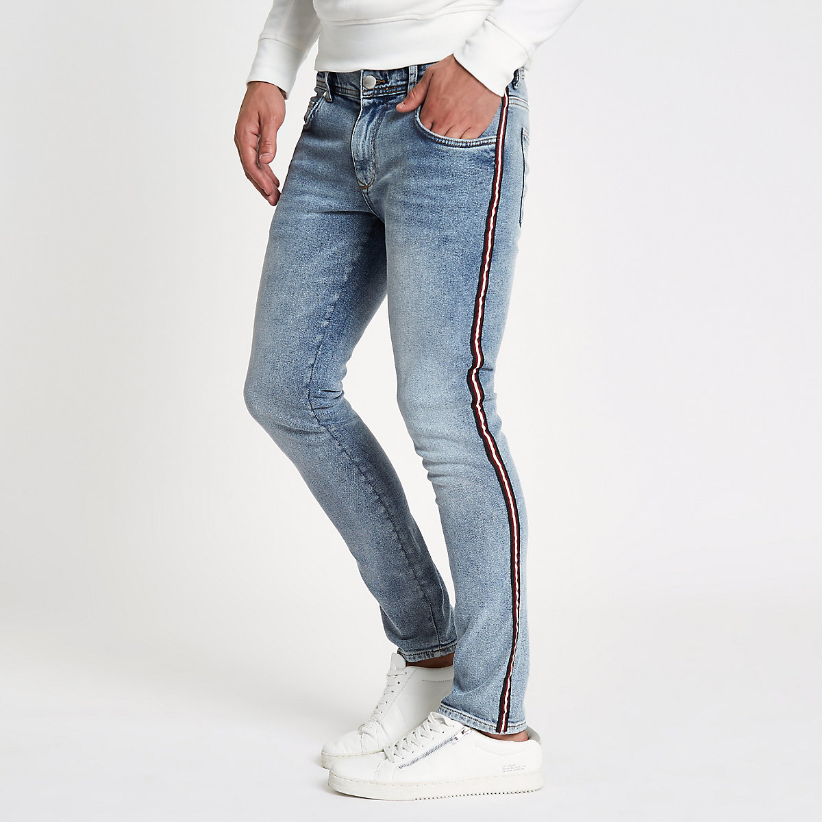 Blue stone wash skinny tape jeans