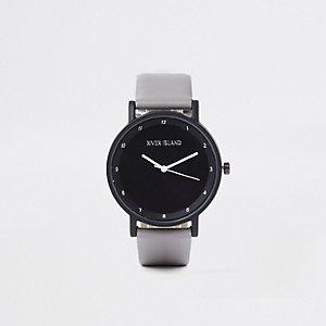 Graue Uhr mit rundem Ziffernblatt