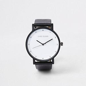 Schwarze Uhr mit rundem Ziffernblatt