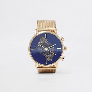 Goldene, runde Armbanduhr mit Gepardenmotiv