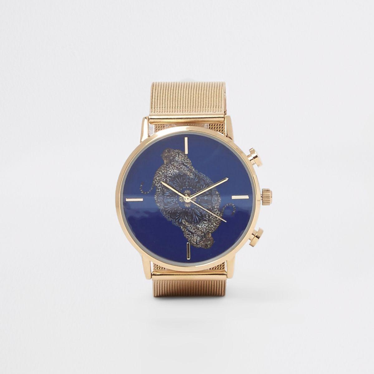 Gold tone cheetah print round watch