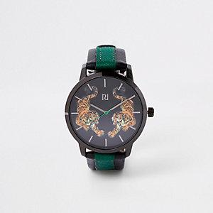 Grijs horloge met ronde wijzerplaat en tijgerprint