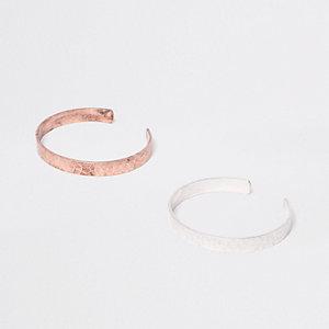Set met zilverkleurige en bronskleurige armbanden