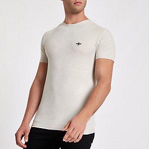 Ecru aansluitend T-shirt met imitatiesuède met wespenprint