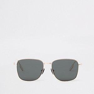 Goudkleurige zonnebril met zeshoekige getinte glazen