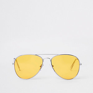 Lunettes de soleil aviateur argentées à verres jaunes