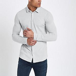 Grijs aansluitend pikeursoverhemd met lange mouwen