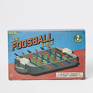 Grey mini foosball table
