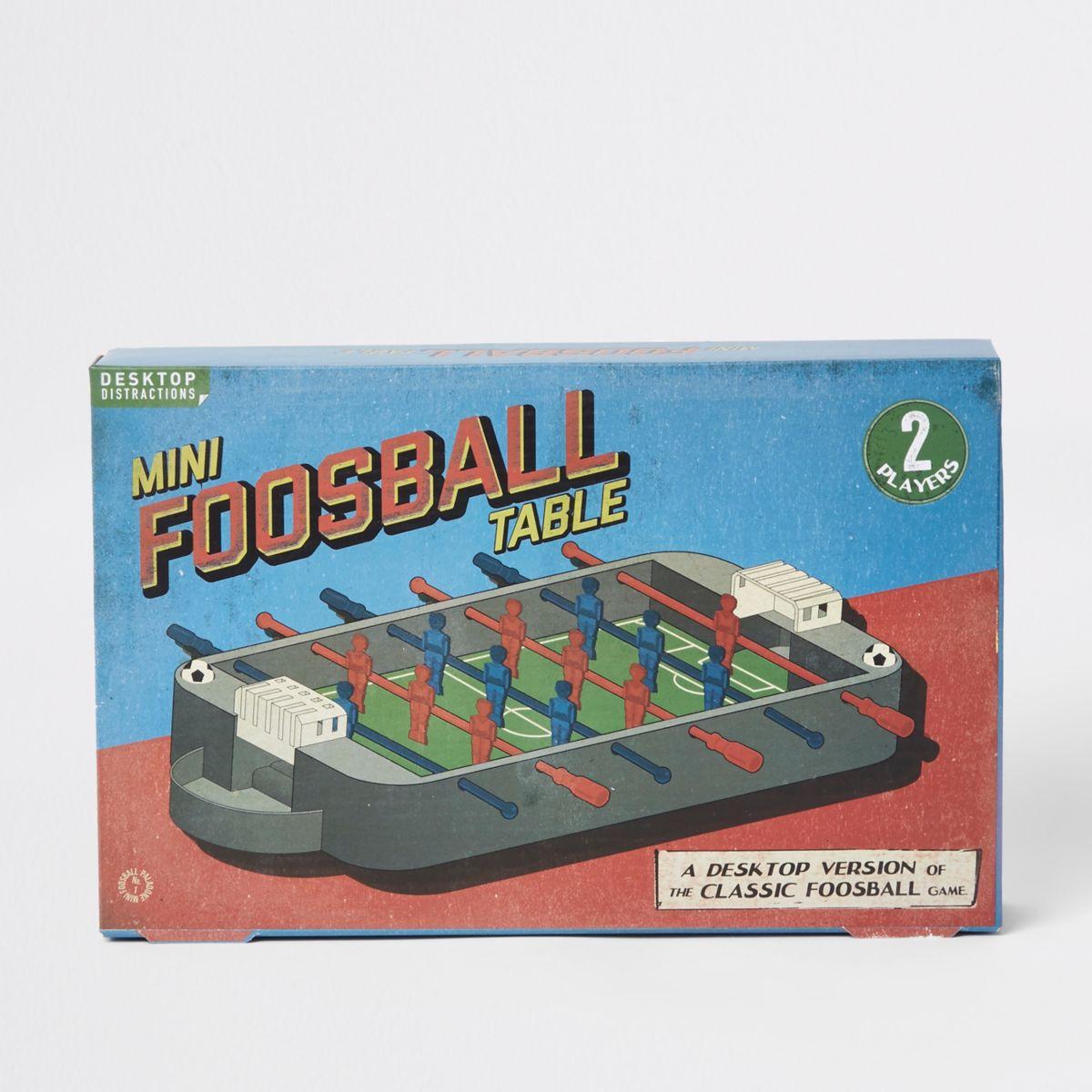 Grey mini foosball table