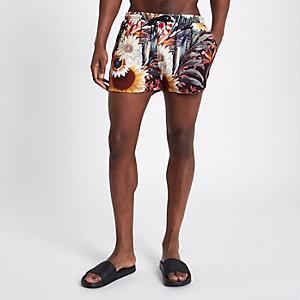 Weiße Shorts mit Sonnenblumenprint
