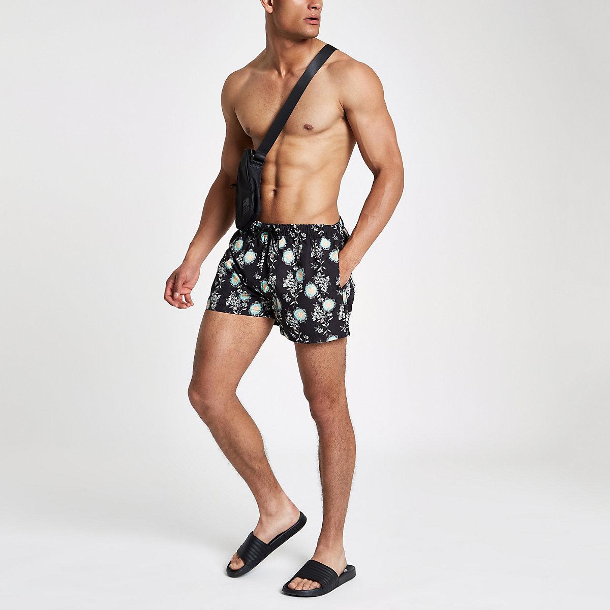 Black skinny fit floral swim trunks