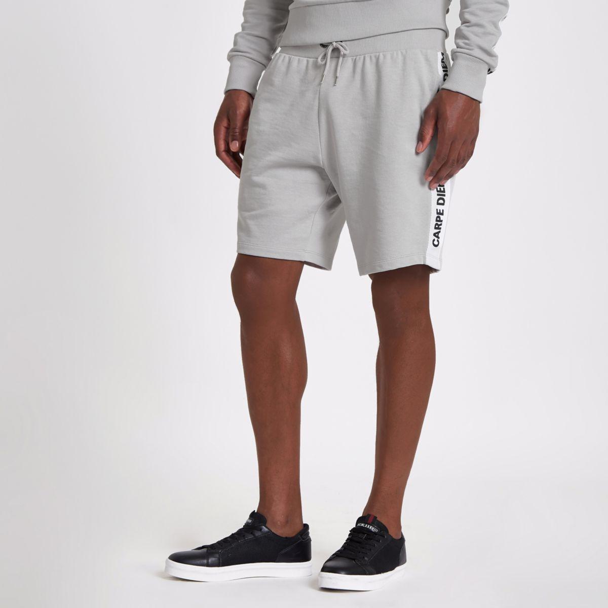 Grey 'carpe diem' tape shorts