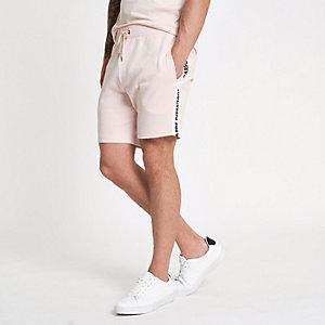 Pink 'carpe diem' tape shorts