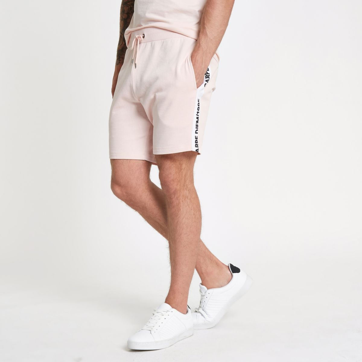 Pink 'carpe diem' tape shorts