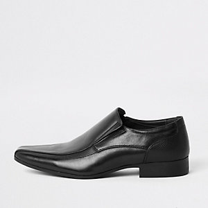 Black faux leather slip on shoes
