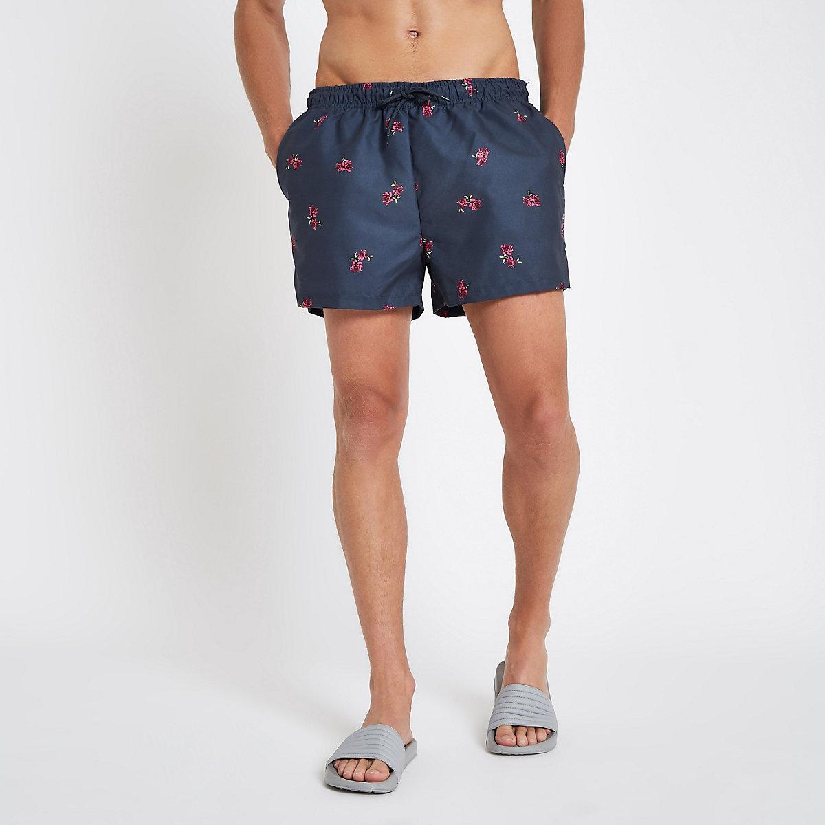 Navy rose print swim shorts
