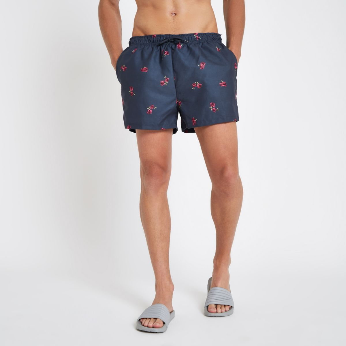 Navy rose print swim shorts