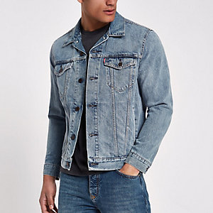 Light blue Levi's denim trucker jacket