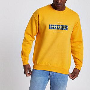 Geel sweatshirt met 'Paradis'-print en lange mouwen