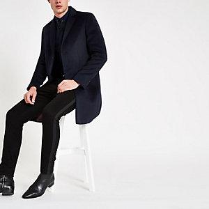 Manteau bleu marine boutonné