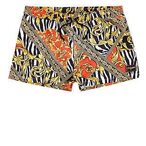 Jaded yellow zebra print swim trunks