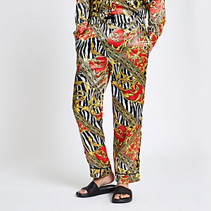 Yellow Jaded zebra print trousers